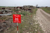 Mine danger sign on a former front line where deminers are set to start working, near Khramort, Nagorno Karabakh, Azerbaidjan, March 2005. The region, although officially located within Azerbaidjan, i... - Boris Heger - 03-03-2005