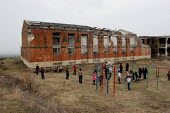 Children play in front of their former school destroyed during the war, Khramort, Nagorno Karabakh, Azerbaidjan, March 2005. The region, although officially located within Azerbaidjan, is being occupi... - Boris Heger - 2000s,2005,Azerbaidjan,break,break time,breaktime,building,BUILDINGS,child,CHILDHOOD,children,Civil War,climbing,conflict,edu education,frame,juvenile,juveniles,kid,kids,outdoors,outside,people,play,P