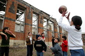 Children play in front of their former school destroyed during the war, Khramort, Nagorno Karabakh, Azerbaidjan, March 2005. The region, although officially located within Azerbaidjan, is being occupi... - Boris Heger - 2000s,2005,Azerbaidjan,ball,balls,boy,boys,break,break time,breaktime,building,BUILDINGS,catch,catching,child,CHILDHOOD,children,Civil War,conflict,edu education,female,females,girl,girls,juvenile,juv