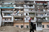 Typical street view with clothes drying up between houses in Stepanakert, Nagorno Karabakh, Azerbaidjan, March 2005. The region, although officially located within Azerbaidjan, is being occupied by Ar... - Boris Heger - 2000s,2005,Azerbaidjan,building,BUILDINGS,cities,city,Civil War,clothes,conflict,displaced,displacement,EBF Economy,EQUALITY,excluded,exclusion,HARDSHIP,houses,housing,idp,idps,impoverished,impoverish