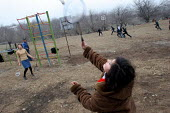 Teenagers play badminton in Drakhtik, Nagorno Karabakh, Azerbaidjan, March 2005. The region, although officially located within Azerbaidjan, is being occupied by Armenia and has became a de facto Repu... - Boris Heger - ,2000s,2005,Azerbaidjan,ball,balls,break,break time,breaktime,child,CHILDHOOD,children,communities,community,conflict,FEMALE,juvenile,juveniles,kid,kids,Leisure,LFL,LIFE,outdoors,outside,people,person