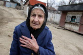 Old woman in the street of Azokh, Nagorno Karabakh, Azerbaidjan, March 2005. The region, although officially located within Azerbaidjan, is being occupied by Armenia and has became a de facto Republic... - Boris Heger - 04-03-2005