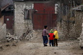 Children walking in the street, Azokh, Nagorno Karabakh, Azerbaidjan, March 2005. The region, although officially located within Azerbaidjan, is being occupied by Armenia and has became a de facto Rep... - Boris Heger - 04-03-2005