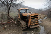 An old tractor lays on the side of the road, Azokh, Nagorno Karabakh, Azerbaidjan, March 2005. The region, although officially located within Azerbaidjan, is being occupied by Armenia and has became a... - Boris Heger - 04-03-2005