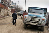 Old man walking in the street, Azokh, Nagorno Karabakh, Azerbaidjan, March 2005. The region, although officially located within Azerbaidjan, is being occupied by Armenia and has became a de facto Repu... - Boris Heger - 04-03-2005