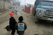 Children coming back from school, Azokh, Nagorno Karabakh, Azerbaidjan, March 2005. The region, although officially located within Azerbaidjan, is being occupied by Armenia and has became a de facto R... - Boris Heger - 04-03-2005