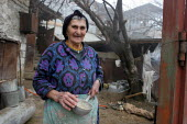 House and woman, Azokh, Nagorno Karabakh, Azerbaidjan, March 2005. The region, although officially located within Azerbaidjan, is being occupied by Armenia and has became a de facto Republic strongly... - Boris Heger - 04-03-2005