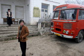 Locals wait for the bus to leave, Azokh, Nagorno Karabakh, Azerbaidjan, March 2005. The region, although officially located within Azerbaidjan, is being occupied by Armenia and has became a de facto R... - Boris Heger - 04-03-2005