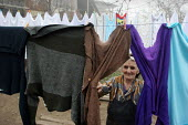 Old lady drying clothes, Azokh, Nagorno Karabakh, Azerbaidjan, March 2005. The region, although officially located within Azerbaidjan, is being occupied by Armenia and has became a de facto Republic s... - Boris Heger - 04-03-2005