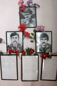 Portraits of Armenian war heroes are on display at the entrance of the elementary school, Khnatzakh, Nagorno Karabakh, Azerbaidjan, March 2005. The region, although officially located within Azerbaidj... - Boris Heger - 03-03-2005