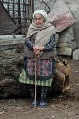 Old lady in the street of Azokh, Nagorno Karabakh, Azerbaidjan, March 2005. The region, although officially located within Azerbaidjan, is being occupied by Armenia since a deadly war got in stand by... - Boris Heger - 04-03-2005