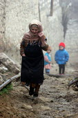 Old lady and children in the street, Azokh, Nagorno Karabakh, Azerbaidjan, March 2005. The region, although officially located within Azerbaidjan, is being occupied by Armenia and has became a de fact... - Boris Heger - 04-03-2005