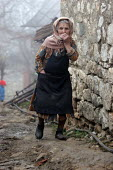Old lady, Azokh, Nagorno Karabakh, Azerbaidjan, March 2005. The region, although officially located within Azerbaidjan, is being occupied by Armenia and has became a de facto Republic strongly linked... - Boris Heger - 04-03-2005