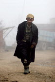 Old man walking in the mist, Azokh, Nagorno Karabakh, Azerbaidjan, March 2005. The region, although officially located within Azerbaidjan, is being occupied by Armenia and has became a de facto Republ... - Boris Heger - 04-03-2005