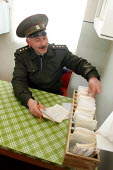 A guard checks prisoner's files in a special institution for detainees having tuberculosis, Baku, Azerbaidjan, March 2005. This disease is widespread in jails of the Caucasus region. - Boris Heger - 14-03-2005