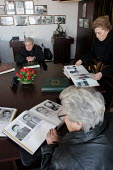Members of a war missings association visit a mausoleum dedicated to their relatives at the war section of the National Cemetery and review books with the photographs of soldiers killed in the separat... - Boris Heger - 07-03-2005