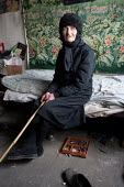 An old lady in her room, in a delapitated residential block transformed into a displaced persons center for Georgians who used to live in Abkhazia, Zugdidi, Georgia, March 2005. The region of Abkhazia... - Boris Heger - 08-03-2005