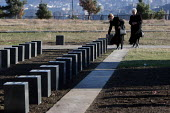 Members of a war missings association come out of a mausoleum dedicated to their relatives at the war section of the National Cemetery after paying their respects, Tbilisi, Georgia, March 2005. The re... - Boris Heger - 07-03-2005