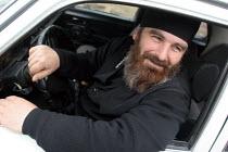 An orthodox priest drives his car, Zugdidi, Georgia, March 2005. - Boris Heger - ,2000s,2005,Asia,asian,asians,christian,christianity,christians,clergy,Coptic Orthodox christian,Eastern Europe,eu,european,europeans,FEMALE,georgia,georgian,georgians,male,man,men,monotheistic,orthod