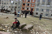 Displaced jobless men in front of a delapitated residential block transformed into a center for Georgians who used to live in Abkhazia, Zugdidi, Georgia, March 2005. The region of Abkhazia, officially... - Boris Heger - 08-03-2005