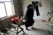 An elderly woman walks in her room, in delapitated residential block transformed into a displaced persons center for Georgians who used to live in Abkhazia, Zugdidi, Georgia, March 2005. The region of... - Boris Heger - 08-03-2005