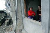 Women talking in a delapitated residential block transformed into a displaced persons center for Georgians who used to live in Abkhazia, Zugdidi, Georgia, March 2005. The region of Abkhazia, officiall... - Boris Heger - 08-03-2005
