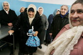 Old women wait for their daily soup, the only meal of the day for most of them, at a charity center, Gagra, Georgia, March 2005. This region of Abkhazia, officially still part of Georgia, conducted a... - Boris Heger - 09-03-2005