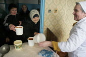Old women receive their daily soup, the only meal of the day for most of them, at a charity center, Gagra, Georgia, March 2005. This region of Abkhazia, officially still part of Georgia, conducted a s... - Boris Heger - 09-03-2005