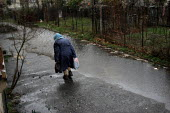 An old lady takes away her daily soup from a charity center, her only meal of the day, at a charity center, Gagra, Georgia, March 2005. This region of Abkhazia, officially still part of Georgia, condu... - Boris Heger - 09-03-2005
