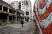 A woman walks past a building destroyed during the war in the Abkhaz capital Sukhumi, Georgia, March 2005. This region of Abkhazia, officially still part of Georgia, conducted a separatist war with Ge... - Boris Heger - ,2000s,2005,Abkhaz,Abkhazian,Abkhazians,Abkhazs,ACE,architecture,Asia,asian,asians,bme minority ethnic,building,buildings,capital,Civil War,conflict,conflicts,culture,damaged,Eastern Europe,EBF,Econom