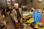 A 82 years old man stands in his room in appalling conditions, in a delapitated residential block transformed into a displaced persons center for Georgians who used to live in Abkhazia, Kutaisi, Georg... - Boris Heger - 10-03-2005