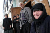 Old people stand in front of an old former official building transformed into a displaced persons center for Georgians who used to live in Abkhazia, Kutaisi, Georgia, March 2005. The region of Abkhazi... - Boris Heger - 10-03-2005