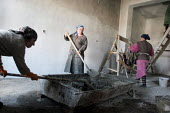 Women work at the renovation of the hospital affected during the war, Chali, Chechnya, March 2005. - Boris Heger - 22-03-2005