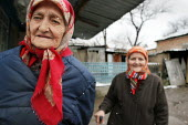 Two old sisters who lost their husbands during the war, in front of their home, Grozny, Chechnya, March 2005. - Boris Heger - 23-03-2005