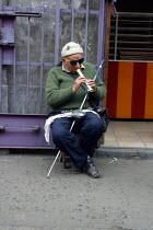 Blind beggar playing flute in the street, Lima, Peru, September 2004 - Boris Heger - 29-08-2004