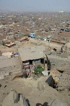 A huge slum in the citys outskirts, Lima, Peru, September 2004. - Boris Heger - 29-08-2004