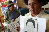 Ayacucho, Peru, September 2004 At the headquaters of the National Association of kidnapped and disappeared persons relatives ANFASEP. Missing's relatives display photographs of their loved ones and ta... - Boris Heger - 29-08-2004