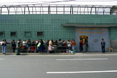 Outside view of the women's central prison with relatives waiting to visit, Lima, Peru, September 2004. - Boris Heger - 29-08-2004