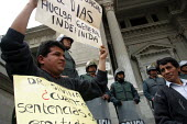 People at a protest are being watched by anti riot policemen, Lima, Peru, September 2004. - Boris Heger - 29-08-2004