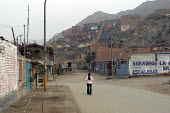Lone girl walking down the street of a slum in the citys outskirts. Lima, Peru, September 2004. - Boris Heger - 29-08-2004