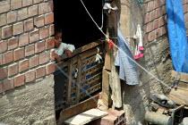 A boy watches by a window, Lima, Peru, September 2004. - Boris Heger - 29-08-2004