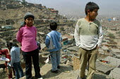 Children playing on a hill overlooking the slum where they live, Lima, Peru, September 2004. - Boris Heger - 29-08-2004