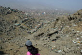A girl passes by on a hill overlooking the slum where she lives, Lima, Peru, September 2004. - Boris Heger - 29-08-2004