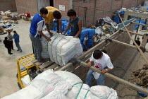 Red Cross workers prepare to send relief material, Lima, Peru, September 2004. - Boris Heger - 29-08-2004