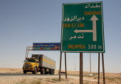 Trafic sign on the roadside mentioning the way to Baghdad, 50 km from the border with Iraq, on the main road from Damas. - Morris Bernard - 24-08-2007