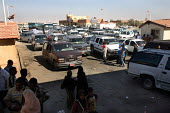Iraqi refugees arriving and queuing on the Syrian side of the border. Al Tanf Iraq-Syria border. - Morris Bernard - , Iraqis,2000s,2007,Arab,Arabs,arrival,arrivals,Arrive,arrived,arrives,arriving,AUTO,AUTOMOBILE,AUTOMOBILES,AUTOMOTIVE,border,border control,border controls,borders,car,cars,CLJ,country,cross crossing