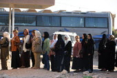 Arriving Iraqi refugee women queue outside of an official building in order to proceed with formality checks on the Syrian side of the border. Al Tanf Iraq-Syria border. - Morris Bernard - 24-08-2007