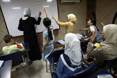 Iraqi refugee children show their interest during a classroom organised by refugee teachers to help children catching back with Syrian levels for the upcoming start of the new school year. There is an... - Morris Bernard - 26-08-2007