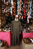 Syrian shoes merchant in front of his stand. Saida Zeinab, Damas, Syria - Morris Bernard - 26-08-2007
