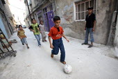 Iraqi refugee children playing football in the street, in this area densely populated with Iraqi refugees. There is an estimated 1.4 million Iraqis who sought refuge in Syria due to the ongoing violen... - Morris Bernard - 30-08-2007
